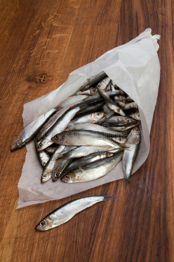 Sardines. In a paper bag royalty free stock images
