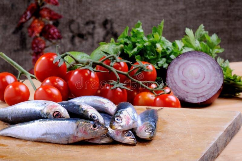 Sardines avec de divers ingrédients images libres de droits