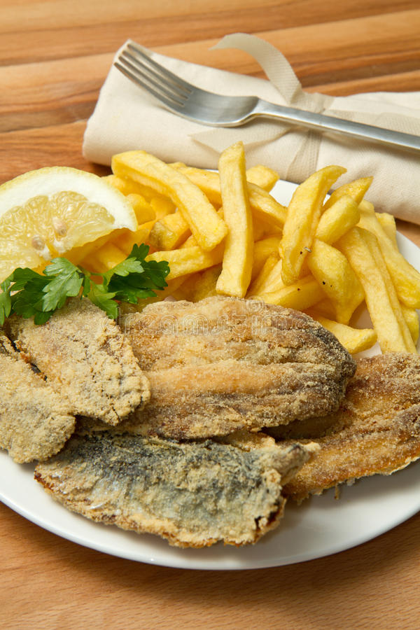 Sardines fried. A dish with sardines fried and potate royalty free stock photography