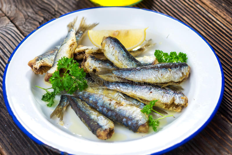 Sardines. With lemon and olive oil royalty free stock photography