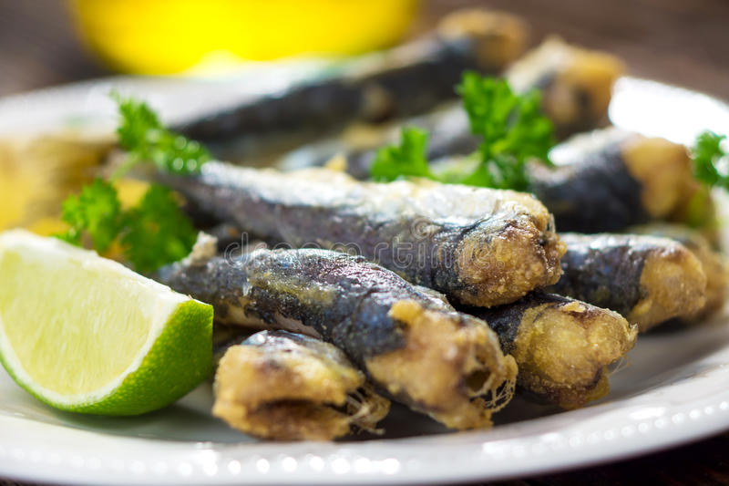 Sardines. With lemon and olive oil stock photos