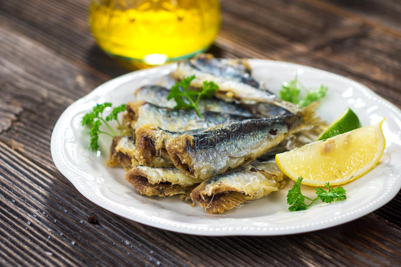 Sardines. With lemon and olive oil royalty free stock images
