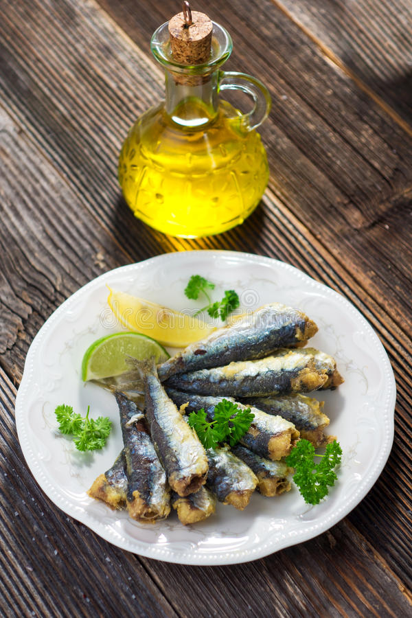 Sardines. With lemon and olive oil stock photography