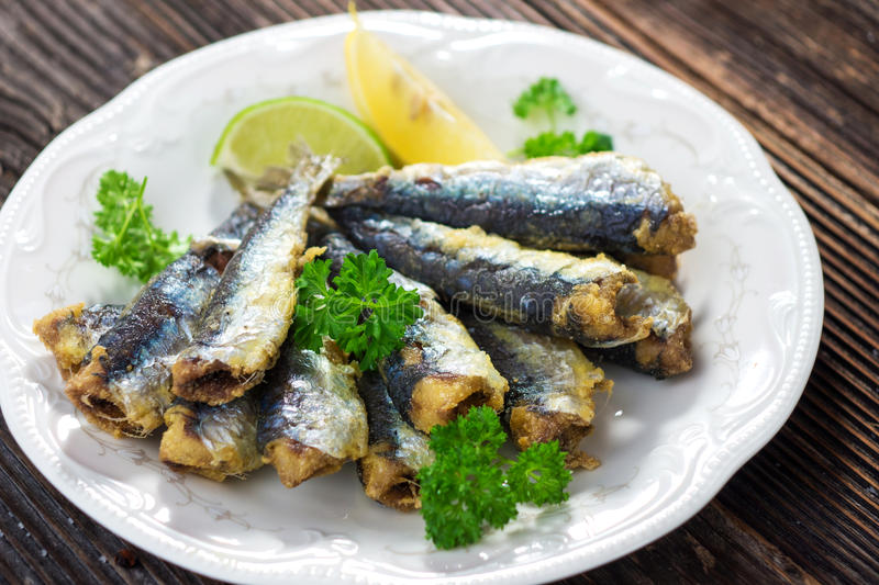 Sardines. With lemon and olive oil royalty free stock photos