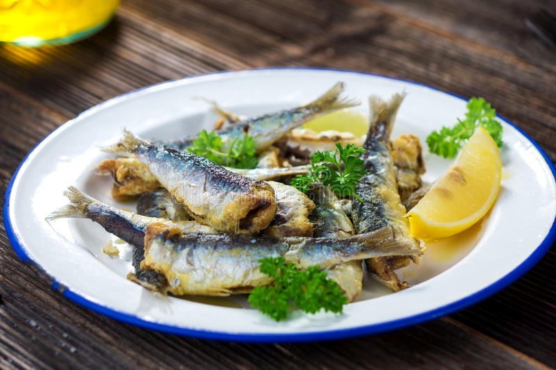 Sardines. With lemon and olive oil stock image
