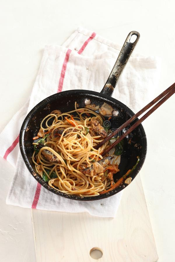Sardines pasta in pan. On white background royalty free stock photos