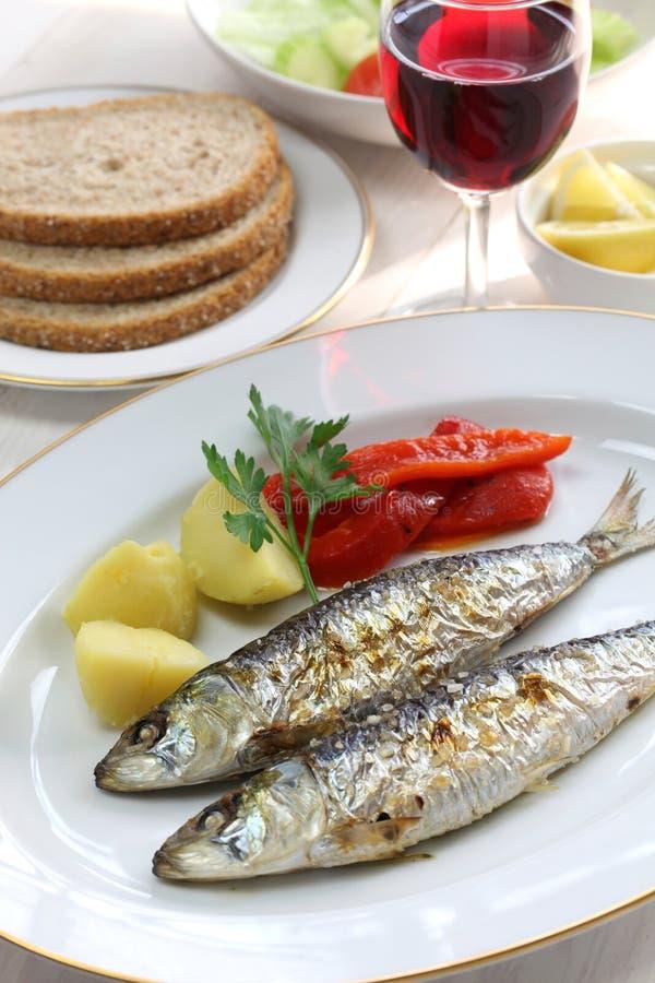 Sardinhas assadas, charcoal grilled sardines. Portuguese food stock images