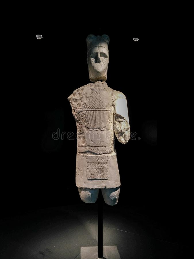 Sardinia. Archeological heritage. The Warriors of Monte Prama. Archaic statue of Shardana warrior with armor and horned helmet stock photos