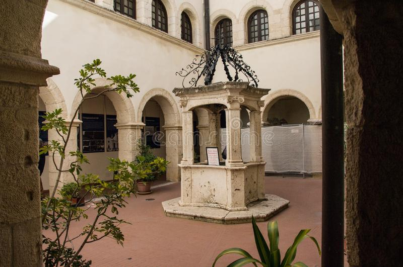 Sardinia. Cagliari. Sanctuary of Nostra Signora di Bonaria. Convent of the mercedarian fathers.  the beautiful well in the center of the small cloister of the royalty free stock photography