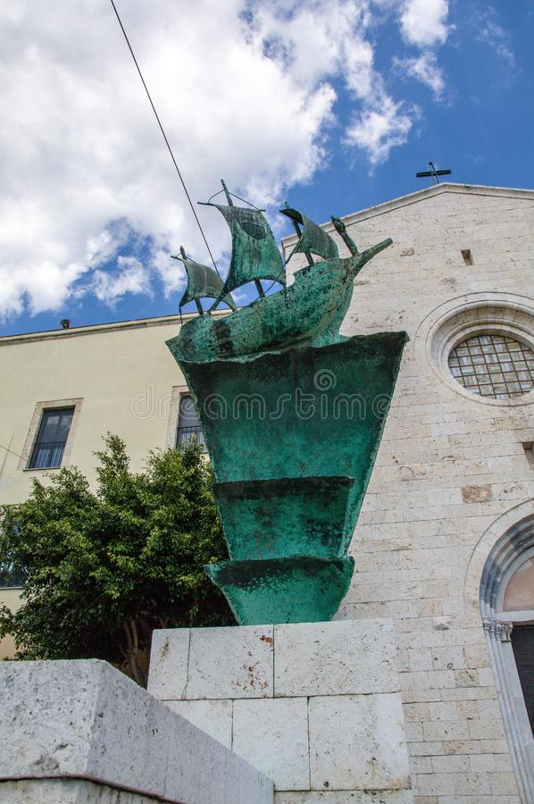 Sardinia. Cagliari. Sanctuary of Nostra Signora di Bonaria. Ship at the mercy of the stormy sea. Bronze sculpture work by the Italian sculptor Franco D' royalty free stock photo
