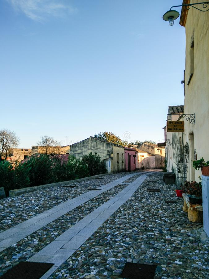 Sardinia. Old and ancient villages. Tratalias Vecchio, a medieval village of in southwestern Sardinia. View of a street with a cobbled and paved street floor stock photo