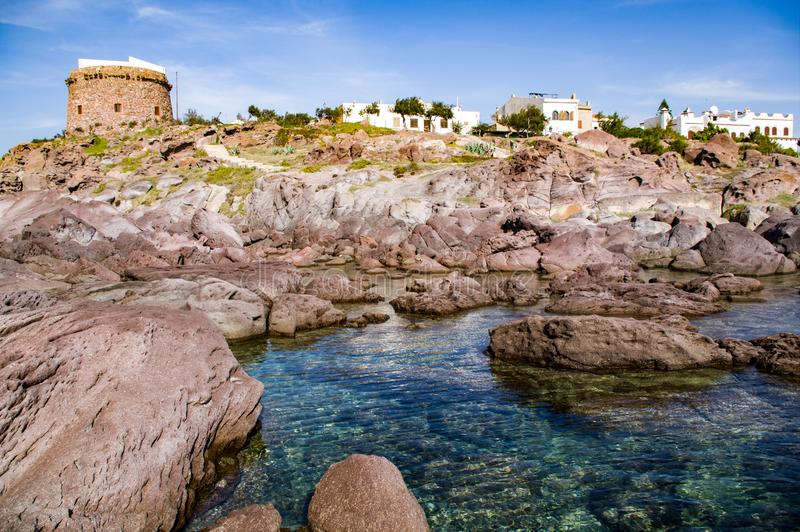 Sardinia. Sulcis. Portoscuso. View from the sea with the ancient Spanish Tower stock photos