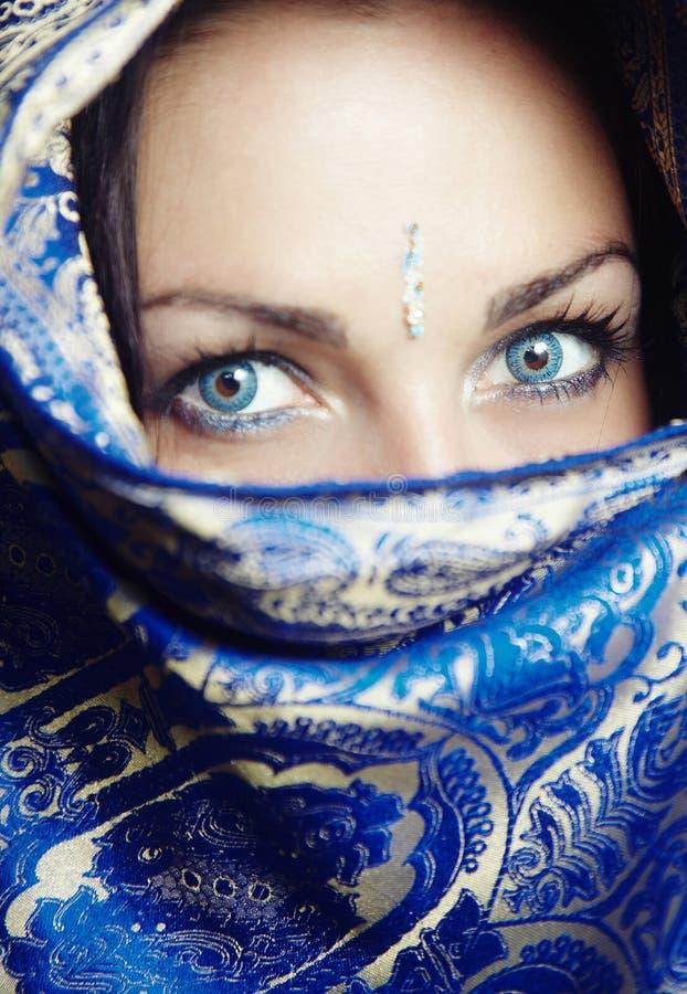 Sari portrait. Close-up portrait of the female face in blue sari. Vertical photo royalty free stock photo