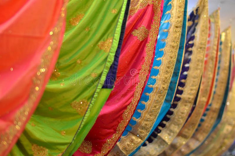 Saree. A sari, saree or shari is a female garment from the Indian subcontinent that consists of a drape varying from five to nine yards 4.5 metres to 8 metres in stock photos