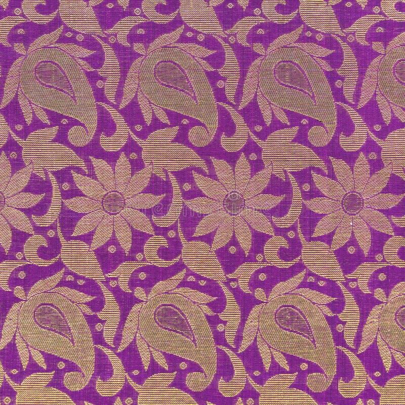 Sari texture detail. Pink sari detail showing golden floral pattern stock images