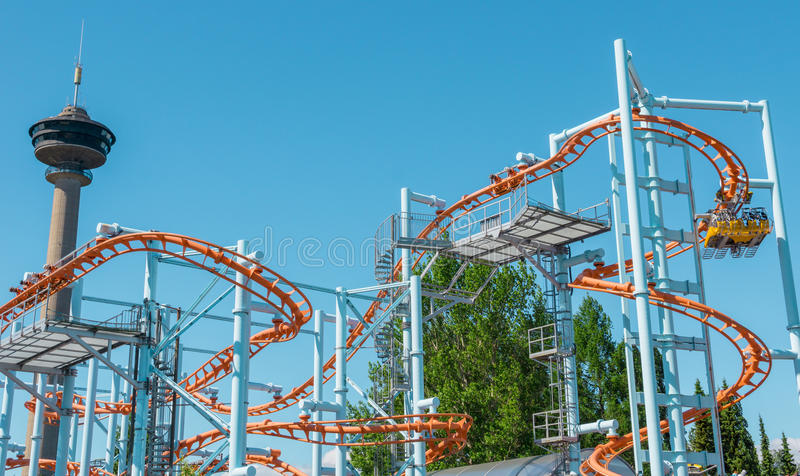 Sarkanniemi Amusement Park, Tampere, Finland. Roller coaster ride and observation tower at Sarkanniemi Amusement Park in Tampere, Finland royalty free stock image
