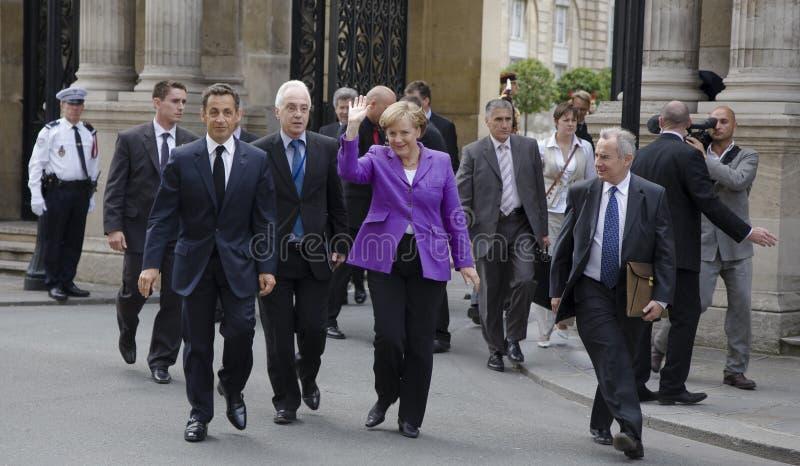 Sarkozy and Merkel. PARIS, FRANCE - JUNE 11 - 2009: French president Nicolas Sarkozy and German chancellor Angela Merkel outside the Elysee Palace on their way stock photos