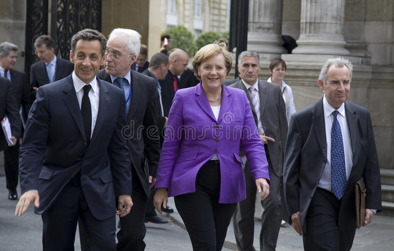 Sarkozy and Merkel. PARIS, FRANCE - JUNE 11 - 2009: French president Nicolas Sarkozy and German chancellor Angela Merkel outside the Elysee Palace on their way royalty free stock images