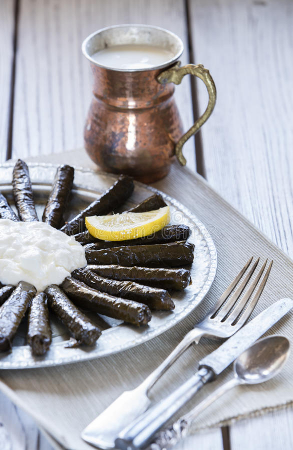 Sarma dish. Rice and mint wrapped in grape vine leaves royalty free stock images