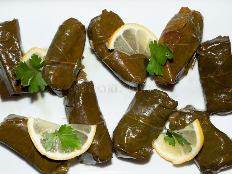 Sarma - Filled or Stuffed Vine Grape Leaves. Sarma Filled or Stuffed Vine Grape Leaves With Lemon and Parsley as Garnish, Traditional Turkish or Greek Cuisine royalty free stock image