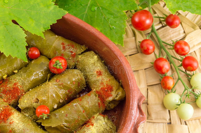 Sarma rolls in a traditional plate and cherry tomato royalty free stock image