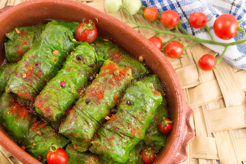 Sarma rolls in a traditional plate and cherry tomato stock image