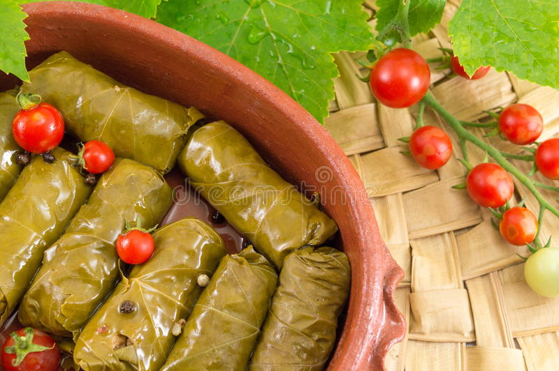Sarma rolls in a traditional plate and cherry tomato stock photo
