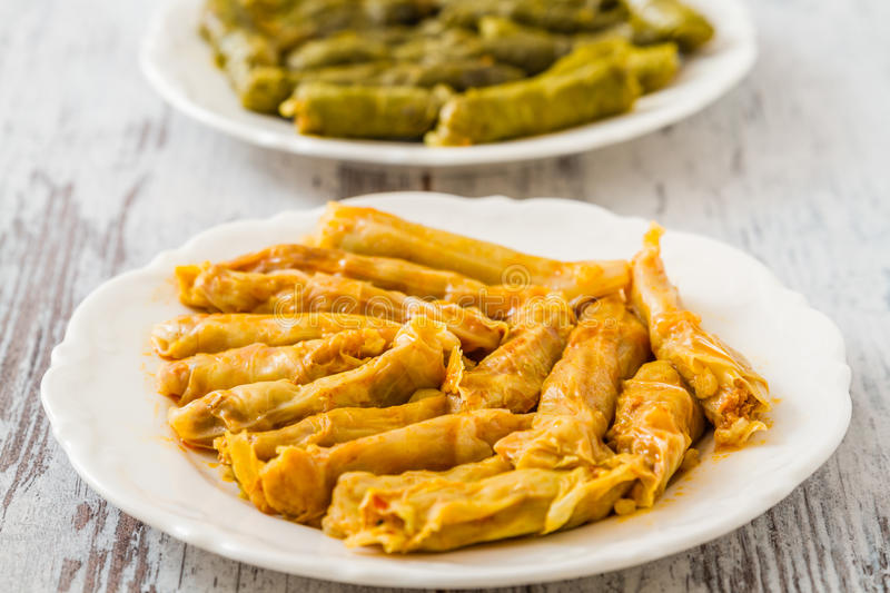 Sarma, Stuffed Grape and Cabbage Leaves. Turkish traditional food Sarma, stuffed grape and cabbage leaves on wooden white background royalty free stock image