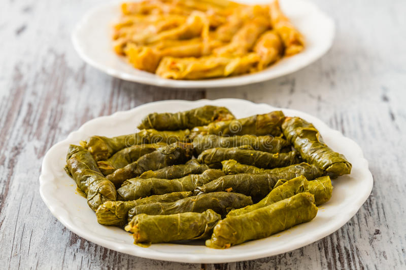 Sarma, Stuffed Grape and Cabbage Leaves. Turkish traditional food Sarma, stuffed grape and cabbage leaves on wooden white background royalty free stock photos