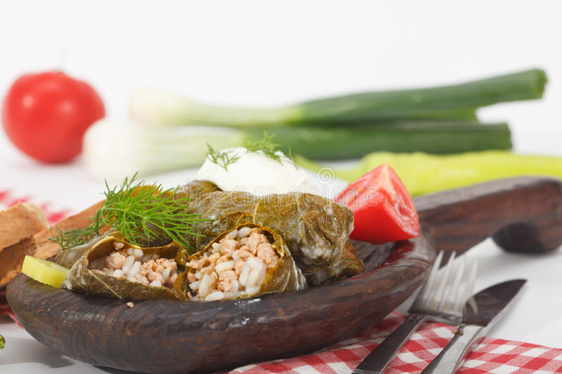 Sarma, stuffed grape leaves in wooden plate stock photos