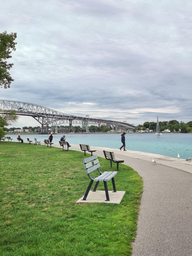Sarnia, Ontario, Canada - September 1, 2019: Blue Water Bridge on boarder between Canada and USA. Famous landmark in America. St. Clair River in towns cities stock images