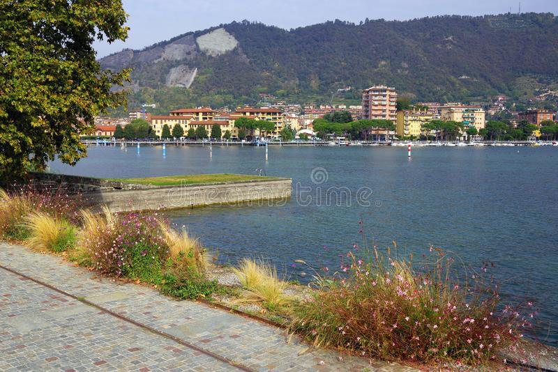 Sarnico town seen from Lungolago Marconi from Paratico, the town from the opposite shore of Lake Iseo. Sarnico is a charming town built where the waters of Lake royalty free stock photo