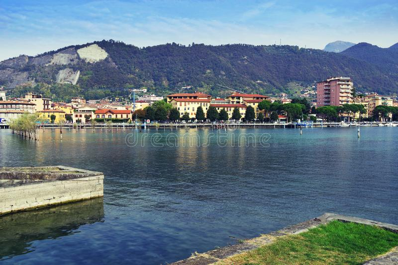 Sarnico town seen from the opposite shore of Lake Iseo, Paratico town. Sarnico is a charming little town built where the waters of Lake Iseo flow out into the stock image