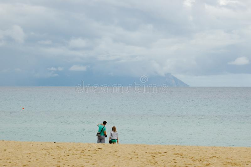 Sarti, Sithonia, Chalkidiki peninsula, Greece, 07. Septembar, 2014. beach on cloudy day. With few people after rain and sea and stormy clouds stock images
