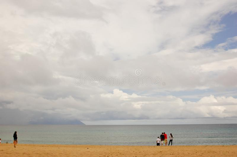 Sarti, Sithonia, Chalkidiki peninsula, Greece, 07. Septembar, 2014. beach on cloudy day. With few people after rain and sea and stormy clouds royalty free stock photos