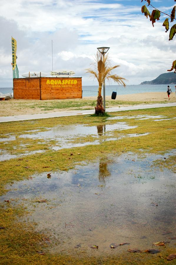 Sarti, Sithonia, Chalkidiki peninsula, Greece, 07. Septembar, 2014. flooded lawn near beach. After storm and rain, with sun and clouds, and reflection on water royalty free stock photos