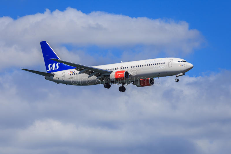 SAS Boeing 737-800. SAS (Scandinavian Airlines System) Boeing 737-800 (without winglets) on approach to land stock photography