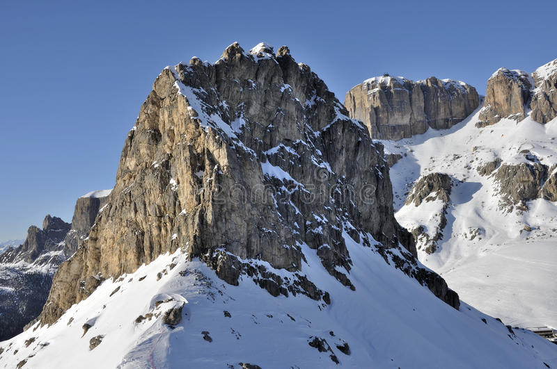 Sas pordoi and piz boe', dolomites. View of famous group in dolomite with steep cliffs and snowy slopes, shot in bright winter light from the east side royalty free stock photos