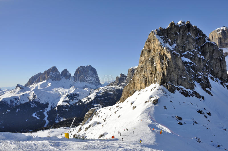 Sas pordoi and sasslungo, dolomites. View of famous mountain in dolomite with steep cliffs and snowy slopes, shot in bright winter light from the east side royalty free stock photo