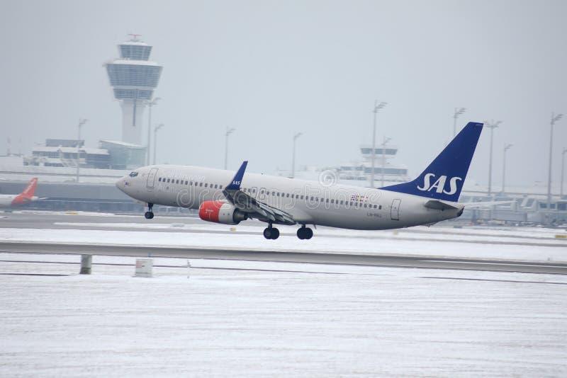 SAS Scandinavian Airlines Boeing 737-800 LN-RRJ in Munich Airport, snow royalty free stock image