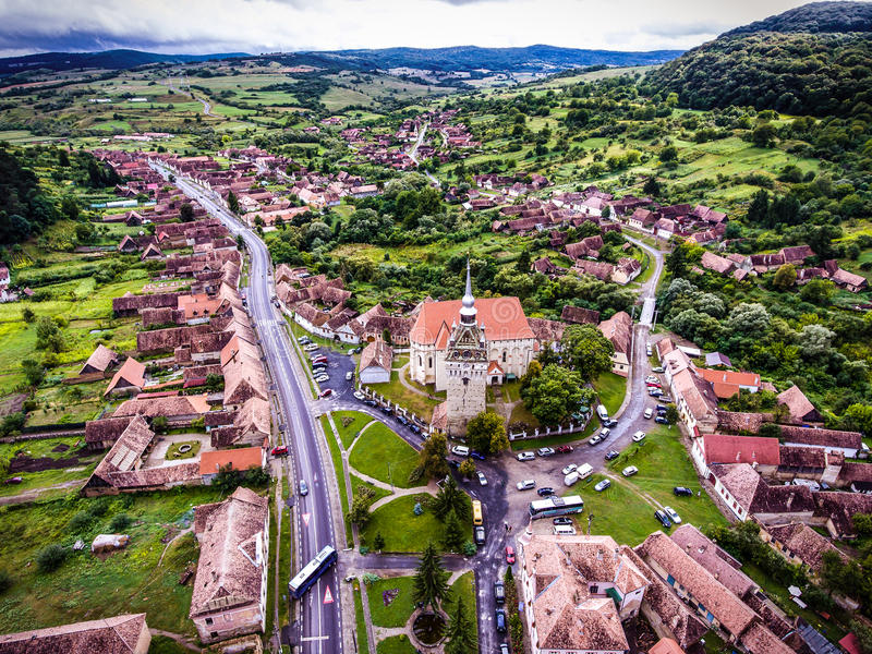 Saschiz saxon village and fortified Church in middle Transylvania, Romania, Eastern Europe. Aerial view from a drone. stock photography