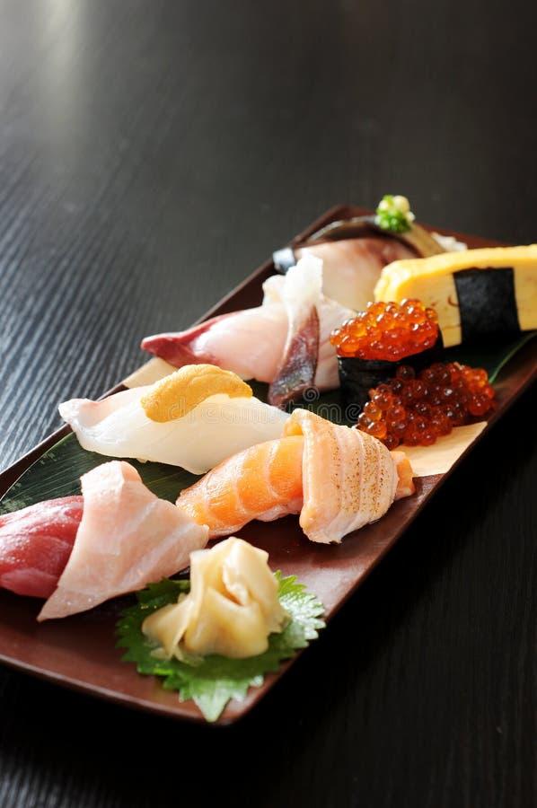 Sashimi. Japanese sashimi on a black dish royalty free stock image