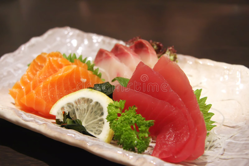 Sashimi arrangement. Arrangement of sashimi sliced raw japanese fish dish stock illustration