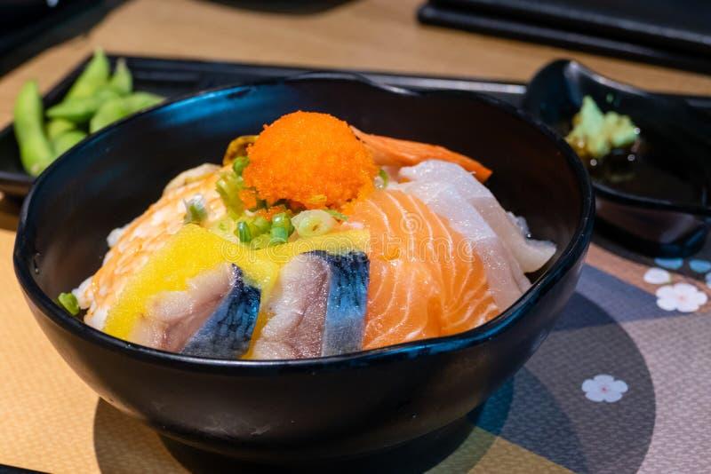 Sashimi bowl with fish eggs and rice. Sashimi in bowl with fish eggs and rice royalty free stock image