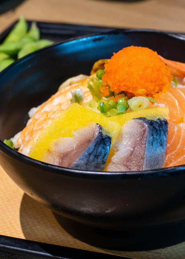 Sashimi bowl with fish eggs and rice. Sashimi in bowl with fish eggs and rice royalty free stock images