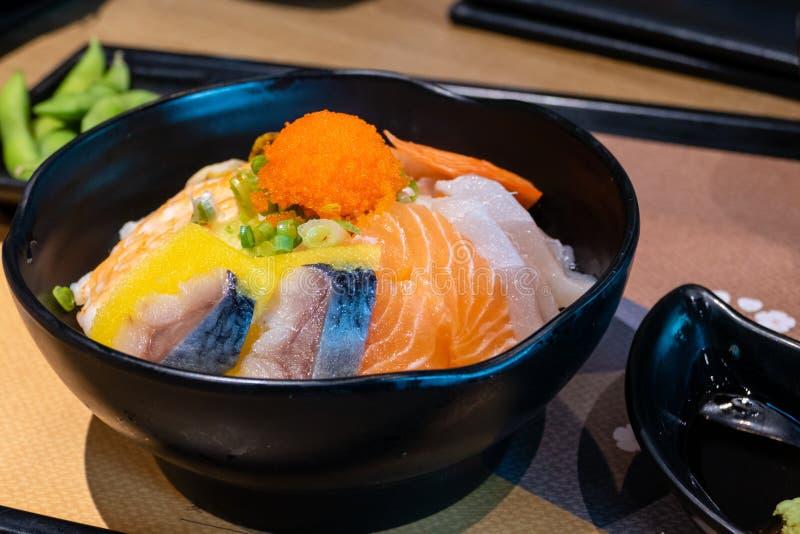 Sashimi bowl with fish eggs and rice. Sashimi in bowl with fish eggs and rice stock photo