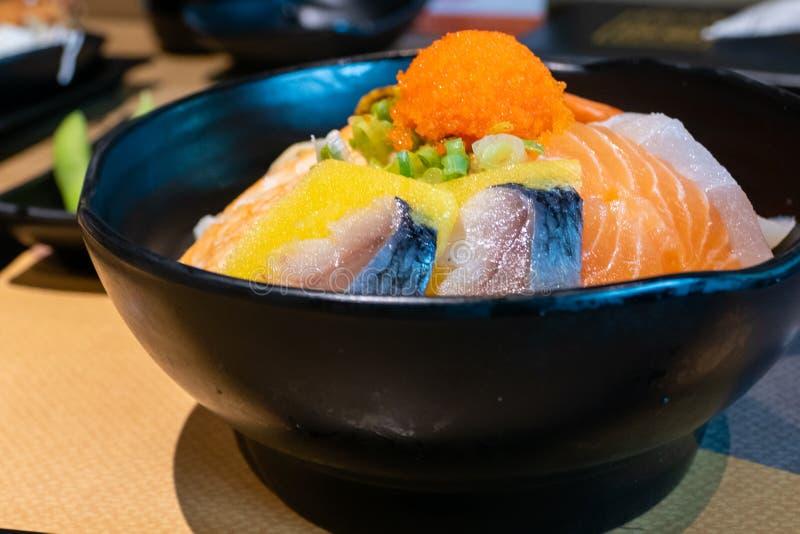 Sashimi bowl with fish eggs and rice. Sashimi in bowl with fish eggs and rice stock images