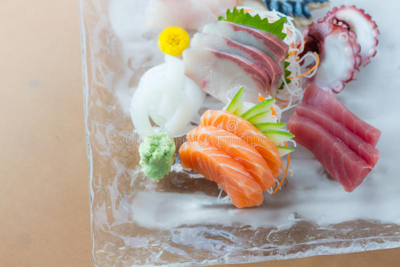 Sashimi dish. Sashimi on iced glass dish, japanese food royalty free stock photos