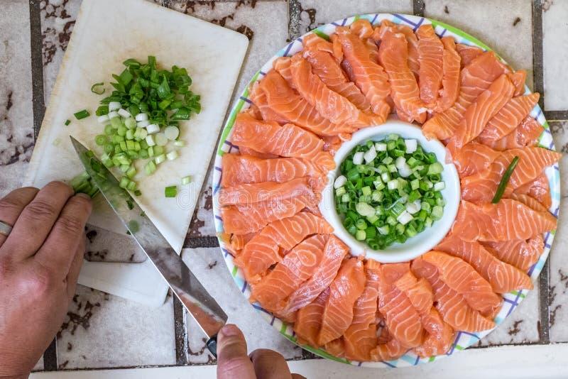 Sashimi japanese food. Prepared sashimi japanese food with onion leaves royalty free stock photo