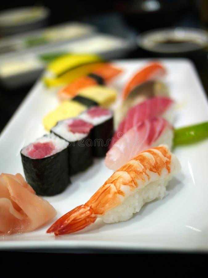 Sashimi plate. Japanese Food Sashimi & Maki plate. Salmon, Tuna, squid and shrimp over rice stock images